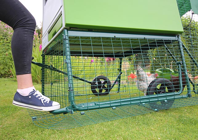 Using the wheels to move an Eglu Cube chicken house.